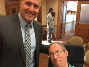 Representative Zimmerman and Ramsey Lee smiling for camera