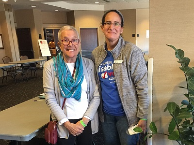 Member of League of Women Voters and Disability Vote Coalition standing together