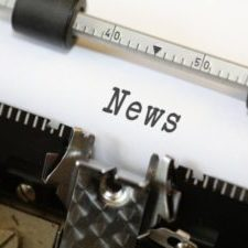 "Closeup of the word ""News"" in an old typewriter"